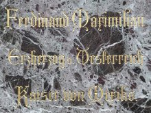 Stone plaque on the monument to Archduke Maximilian on the main square in Hietzing