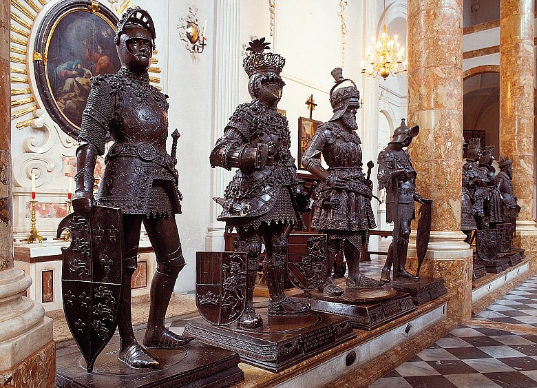Bronze statues in the Court Church at Innsbruck; on the left the figure of King Arthur