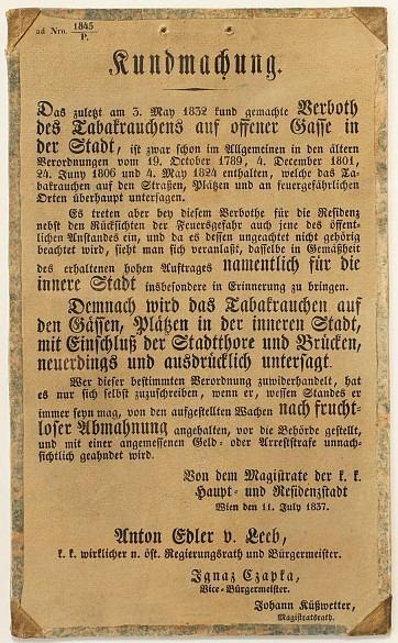 Official notice announcing a ban on smoking in the city centre of Vienna, near the city gates and on bridge...